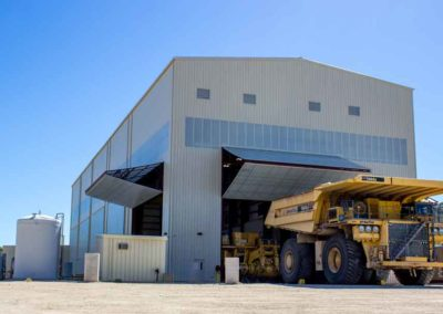 Ground view of bi fold doors and Kamatsu dump truck