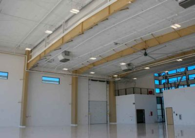 Inside shot of finished apoxy floors of the Triple C hanger at Scottsdale Airport with the bi-fold door open