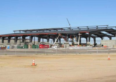Side view of WestWorld of Scottsdale Equestrian Center with exposed roof purlins